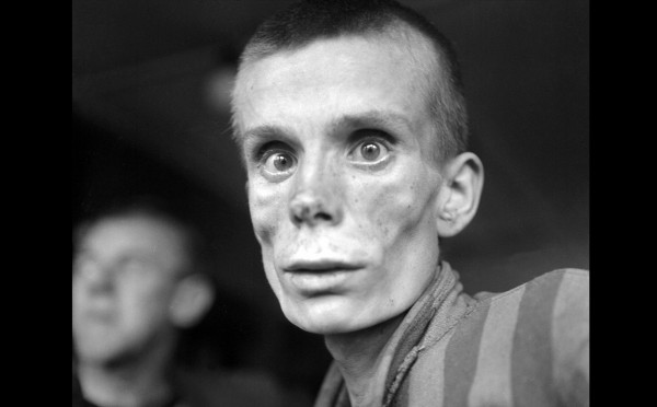 An-emaciated-18-year-old-Russian-girl-looks-into-the-camera-lens-during-the-liberation-of-Dachau-concentration-camp-in-1945.-Dachau-was-the-first-German-concentration-camp-opened-in-1933.-More-than-200000-people-were-detained-be-600x372