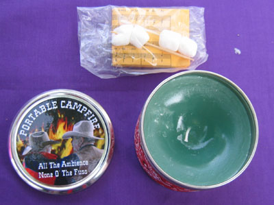 Inside the tin, a candle, teeny marshmallows for roasting, and the lyrics to some campfire songs